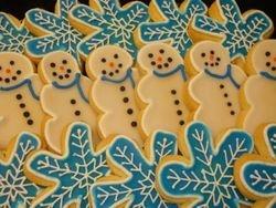 simple snowmen cookies $2.00/ea,, snow flakes $3 each