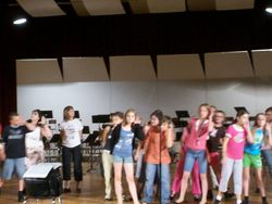 Susan works with the campers during dress rehearsal.