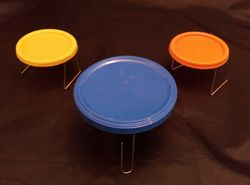 Table and chairs made from jar lids
