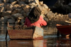 Muslim woman in boat