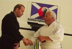 Persentation of Fujii Award to Craig Mackay by Sensei Brian Ford
