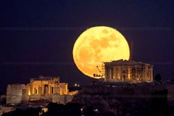 Full Moon rising over the Acropolis