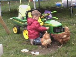 Oscar mending in tractor
