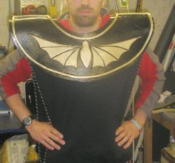 A pharoic style shoulder piece