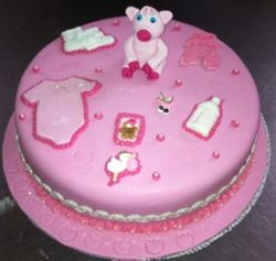 Babyshower themed cake in  pink