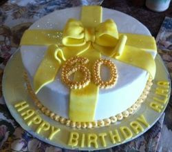 60th Birthday with yellow fondant Ribbon cake