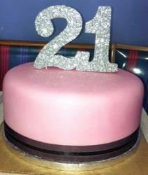 21st pink and black fondant cake