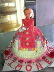 Doll cake with sweets as decor