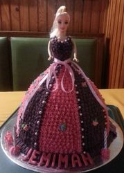 Doll themed cake with barney purple icing