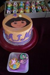 Dora themed cake and cupcakes