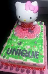 Hello Kitty themed cake with plastic figurine