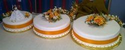 3tier wedding cake with orange band