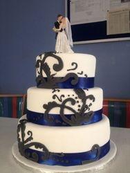 3 tier wedding cake with blueribbon and blackfondant decor