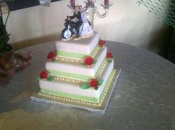 3 tier wedding cake with bike topper