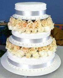 3 tier wedding cake with fresh white and cream roses