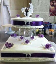 2 tier wedding cake with purple band