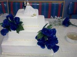 3tier wedding cake with blue silk flowers