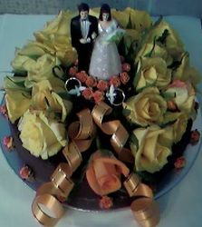 2tier wedding cake with yellow fresh roses