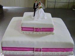 2 tier wedding cake with cerise band