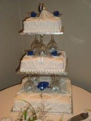 3 tier wedding cake with blue fondant flowers