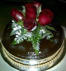 Sachertorte with fresh red roses - wedding cake