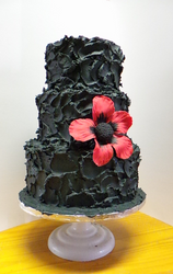 Black Butter Icing cakes with Red Fondant Flowers.