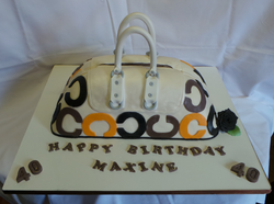 Calvin Klein themed handbag cake.