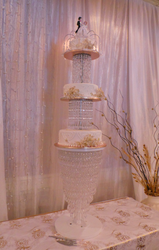 Three tier white wedding cake