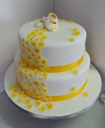 Yellow flower and booty baptism cake