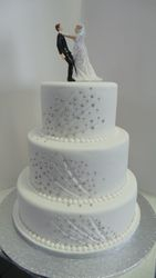 Three Tier Wedding Cake with bride choking groom wedding topper