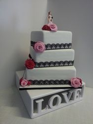 White, Black and pink themed wedding cake