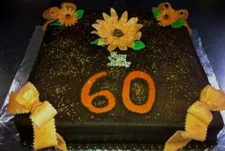 Chocolate 60th Birthday cake with fondant Ribbons