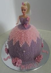 Pastel coloured Doll themed cake