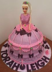 Doll themed cake with pink icing