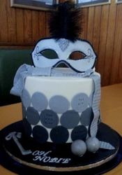 Gumpaste mask on Fifty shades of Grey themed cake