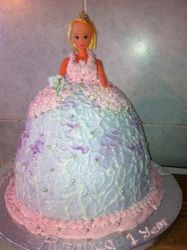 Doll cake with pink and white buttericing