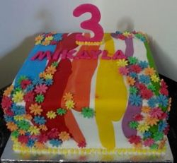 Rainbow cake covered with colourfull fondant