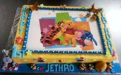 Winnie the Pooh themed cake with fondant decor