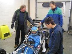 Seat fitting in workshop at Pembroke Dock