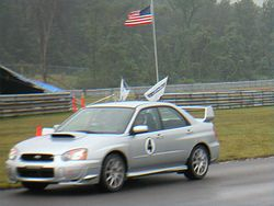Amanda on a hotlap in a Subaru Impreza STi