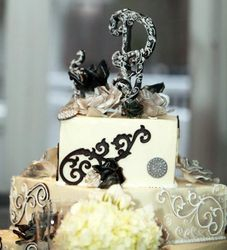 Scrolls in black on white wedding cake with silver, black and white wedding cake