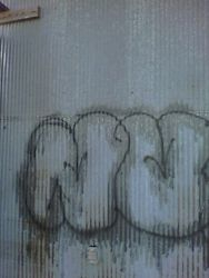 Graffiti removal from steel
