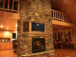 Full two story rock fireplace