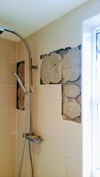 Tile falling off wall