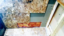 Marble falling off wall