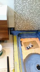 Seal the seams around the wetroom tray