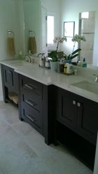 "The master vanity is a deep stained maple, with 3"" posts."