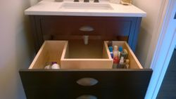 The powder room vanity, drawer open.  A plumbers nightmare, but they handled it perfectly.
