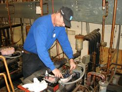 Mike changing a valve plate.