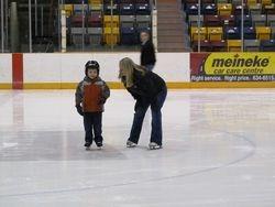 Zachary getting skating tips from Yvette